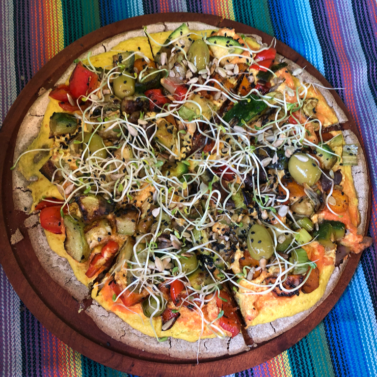Vegan user review of Curcuma in El Chalten. Gluten free pizza with buckwheat and rice flour crust and lots of veggies and sprouts. They have a large and a small (individual). Note: The olives have pits in them.