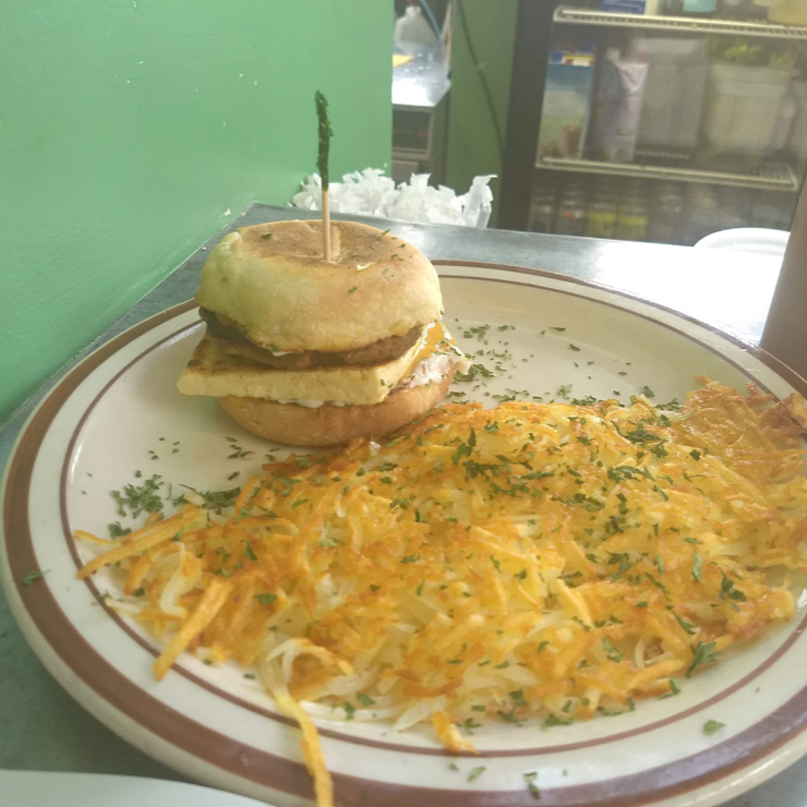 Vegan user review of Wayward Vegan Cafe in Seattle. So long Egg McMuffin. Say hello to The Real Deal. English muffin, sausage patty, tofu and cheese served with hash browns.