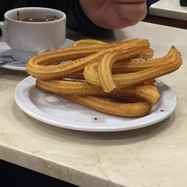 Vegan user review of Los Artesanos 1902 Chocolate in Madrid. Eating Chocolate y churros is a favorite late night snack. Plain, deep fried dough dipped in thick sipping chocolate.